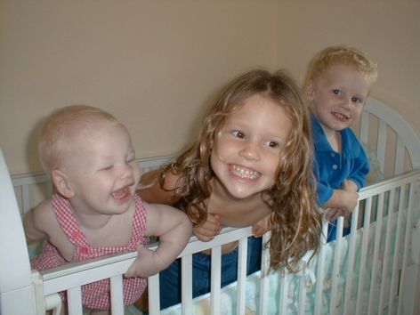 three big smiles in the crib copy